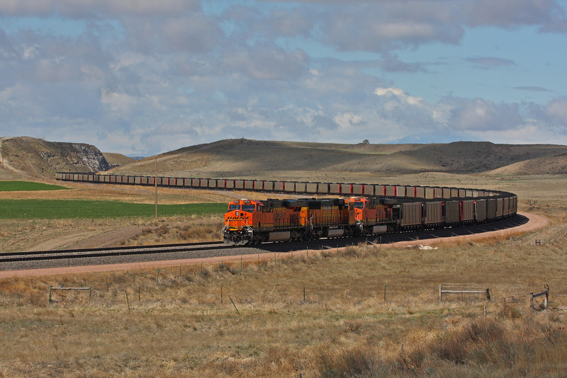 This mile long train is heading to Houston, TX were it will power the city for 2 days. Near Ft. Laramie, Wyoming.