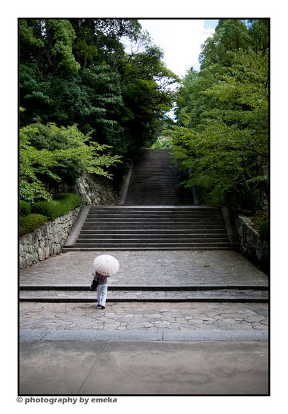contemplating the long walk up the stairs to the Gion temple