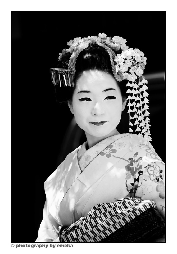 Geisha?  Perhaps not a real one, but rather a tourist dressed to emulate one