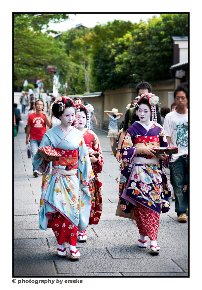 Geishas?  Authentic Geisha are reportedly very difficult to spot.  These individuals are likely Japanese tourists dressed to emulate the iconic figures.