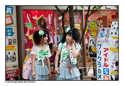 "a couple of ""Harajuku Girls"" hanging out"