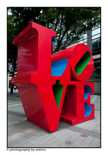 L . O . V . E -- a copy of the iconic art form designed by Robert Indiana, sitting beneath the Shinjuku I-LAND Tower in Nishi-Shinjuku office district