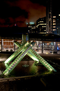 Olympic flame structure in green with Convention Centre
