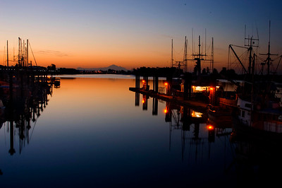 Early morning hours is magic. here Mount Baker in the background stands between the fishingboats at Steveston, Richmond B.C. Canada