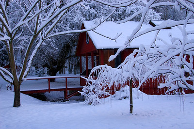 little red house at Grant Landing in the snow