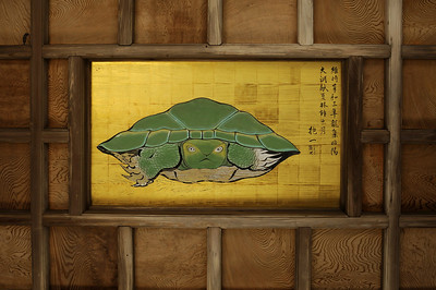 Famous image of a turtle on the ceiling of the gate to the Okutsu-no-miya Shrine. Its eye appear to follow any who stand under the painting.