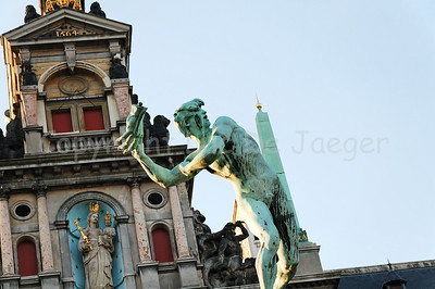 "Bronze statue of Brabo on the Market Square in Antwerp (Antwerpen), Belgium. The statue is built in 1887 and represents Silvius Brabo, throwing a hand (hence in Dutch Antwerpen, meaning: ""handwerpen"" or freely translated ""throwing a hand"")."