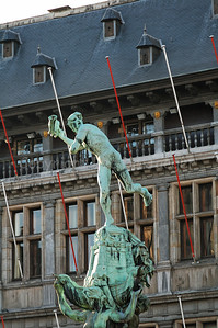"The bronze statue of Brabo on the Market Square in Antwerp (Antwerpen), Belgium. The statue is built in 1887 and represents Silvius Brabo, throwing a hand (hence in Dutch Antwerpen, meaning: ""handwerpen"" or freely translated ""throwing a hand"")."