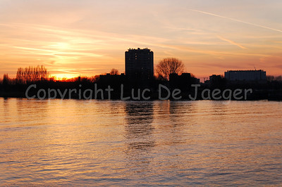 Sunset along the banks of the River Scheldt in Antwerp (Antwerpen), Belgium.
