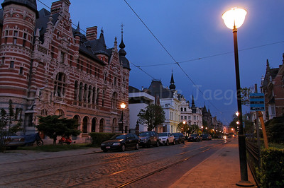 The Cogels-Osylei in Antwerp - Berchem (Antwerpen), Belgium, a street full of art deco/art nouveau houses and buildings, captured at dusk.