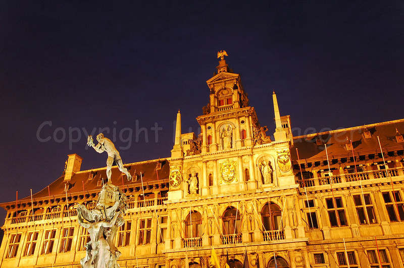 The Town Hall of Antwerp (Antwerpen), Belgium captured at dusk. In front of the Town Hall, on the Market square, is the bronze statue of Brabo.