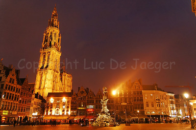 The Market square and the Cathedral of Our Lady in Antwerp (Antwerpen), Belgium captured at dusk.