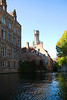 Bruges, Belgium - along the Canals of Bruges with the Belfry in Market Square in the background