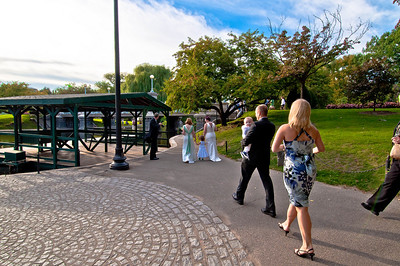 A wedding party walks through the Public Garden in Boston