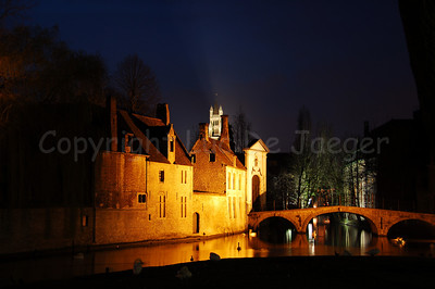 Evening shot of the walls of the Beguinage (Begijnhof) and the brdige leading to it. The Saint Saviour's Cathedral (St Salvatorskathedraal) is far in the background.