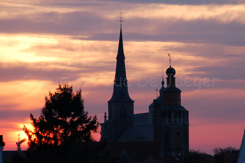 Sunset captured from the first windmill (Bonne Chiere molen) along the Kruisvest, near the Kruispoort in Bruges (Brugge), Belgium with a view on the Jerusalem Church (Jeruzalemkerk).