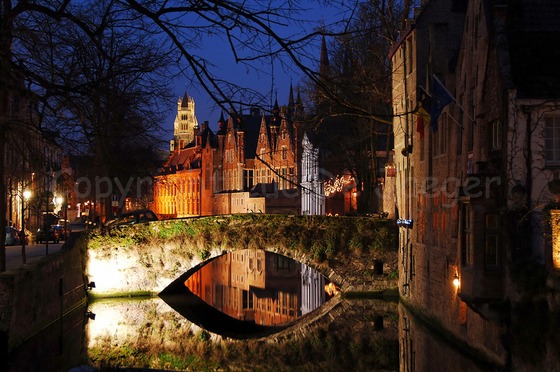 Bridge (Peerdenbrug) along the Groenerei shot at sunset from the bridge between the Langestraat and the Hoogstraat in Bruges (Brugge), Belgium. In the center of the photo, in the background, is the Saint Salvator's Cathedral (Sint-Salvatorskathedraal).