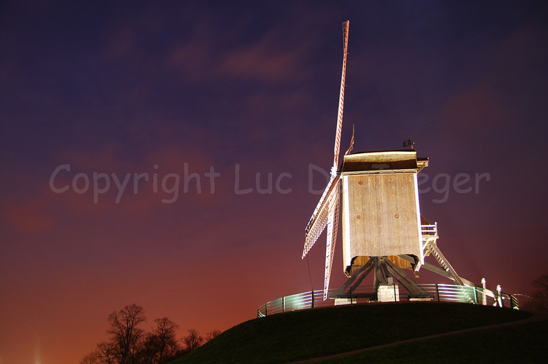"""One of the four mills (molens) along the Kruisvest in Bruges (Brugge), Belgium. This one is the 2nd, counting from the Kruispoort, named """"Sint-Janshuismolen"""" (built in 1770). The Sint Janshuis Mill grinds grain and is still operating today. Shot at sunset."""