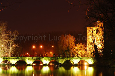 "Night image of the bridge leading to the Minnewaterpark. To the right is the ""Poertoren"" (Powder Tower) which was once a munition depot. Hence the very thick walls of the Tower."