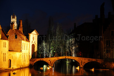 Evening view of the bridge leading to the beguinage (Begijnhof) in Bruges (Brugge), Belgium. Shot around Xmas 2006.