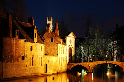 Evening view of the bridge leading to the beguinage (Begijnhof) in Bruges (Brugge), Belgium. Shot around Xmas 2006.