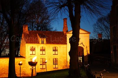 Evening shot of the entrance (Wijngaardpark) of the Beguinage (Begijnhof) in Bruges (Brugge), Belgium. Shot around Xmas 2006.