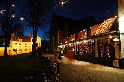 Evening shot of the road in the Wijngaardpark leading to the entrance -- just in front of you -- of the Beguinage (Begijnhof) in Bruges (Brugge), Belgium. Shot around Xmas 2006.