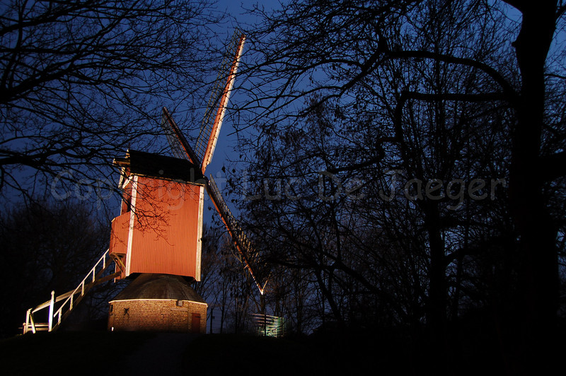 """One of the four mills (molens) along the Kruisvest in Bruges (Brugge), Belgium. This one is the 3rd, counting from the Kruispoort, named """"De Nieuwe Papegaai"""" (built in 1790 and rebuilt in 1970). Shot at sunset."""