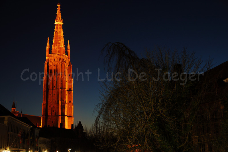 """View on the tower of the Church of Our Lady (Onze-Lieve-Vrouwekerk), zoomed in from the bridge between the """"Dijver"""" and the """"Rozenhoedkaai"""" in Bruges (Brugge), Belgium. The tower reaches a heigth of 122 meters, which makes it the second highest church tower in Belgium (The cathedral of Antwerp has the highest  tower: 123 m !)."""