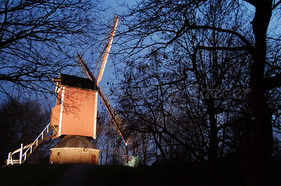 "One of the four mills (molens) along the Kruisvest in Bruges (Brugge), Belgium. This one is the 3rd, counting from the Kruispoort, named ""De Nieuwe Papegaai"" (built in 1790 and rebuilt in 1970). Shot at sunset."