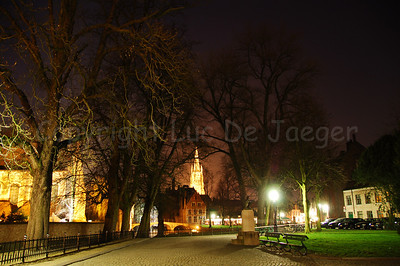 Evening shot of the Wijngaardplein in Bruges (Brugge), Belgium with the Church of Our Lady (Onze-Lieve-Vrouwekerk) in the center.
