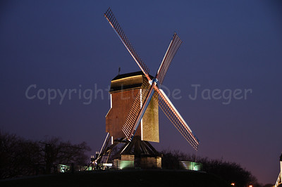"One of the four mills (molens) along the Kruisvest in Bruges (Brugge), Belgium. This one is the 2nd, counting from the Kruispoort, named ""Sint-Janshuismolen"" (built in 1770). The Sint Janshuis Mill grinds grain and is still operating today. Shot at sunset."