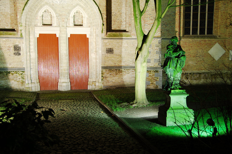 Bronze statue (full of moss making it green) in front of the Saint Salvator's Cathedral or Saint Savior's Cathedral (Sint-Salvatorskathedraal).