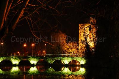 Evening shot of the bridge and the Poertoren in the Minnewaterpark in Bruges (Brugge), Belgium. Shot around Xmas 2006.