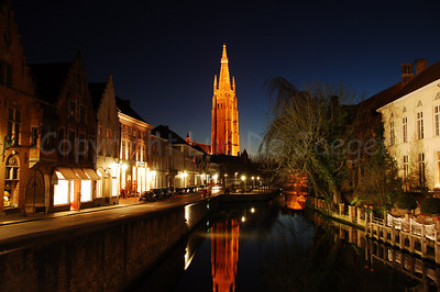 "View on the Church of Our Lady (Onze-Lieve-Vrouwekerk) (in the middle), seen from the bridge between the ""Dijver"" and the ""Rozenhoedkaai"" in Bruges (Brugge), Belgium. The tower reaches a heigth of 122 meters, which makes it the second highest church tower in Belgium (The cathedral of Antwerp has the highest  tower: 123 m !)."