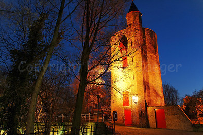 "The ""Poertoren"" (Powder Tower), shot at dusk, which was once a munition depot. Hence the very thick walls of the Tower. The Tower is situated along the Minnewaterpark in Bruges (Brugge), Belgium."