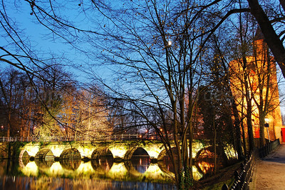 "Image, shot at dusk, of the bridge (built in 1740) leading to the Minnewaterpark. To the right is the ""Poertoren"" (Powder Tower) which was once a munition depot. Hence the very thick walls of the Tower."