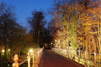 The bridge (built in 1740) leading to the Minnewaterpark in Bruges (Brugge), Belgium. Shot at dusk.