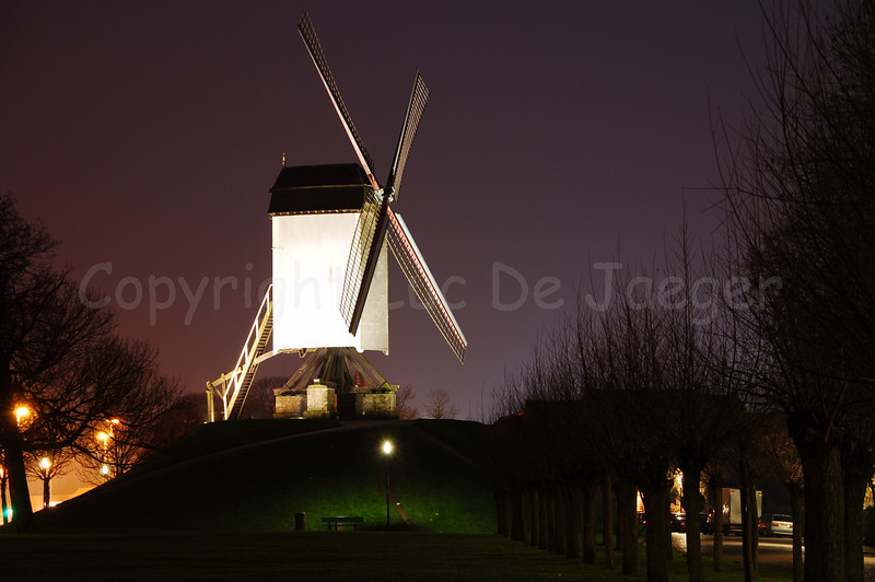 """One of the four mills (molens) along the Kruisvest in Bruges (Brugge), Belgium. This is the 1st mill, counting from the Kruispoort, named """"Bonne-Chièremolen"""" (built in 1844). Shot at sunset."""