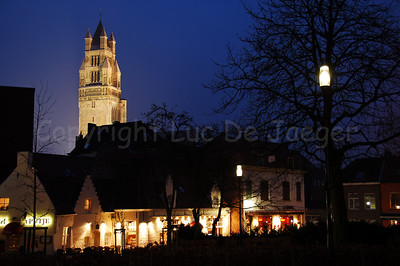 The Saint Saviour's Cathedral behind the restaurants in front of the Concert Hall situated along 't Zand.