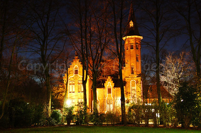Evening shot of the Minnewater Castle in the Minnewaterpark in Bruges (Brugge), Belgium. Shot around Xmas 2006.