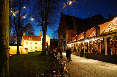 Evening shot of the road in the Wijngaardpark leading to the entrance of the Beguinage (Begijnhof) -- just in front of you -- in Bruges (Brugge), Belgium. Shot around Xmas 2006.