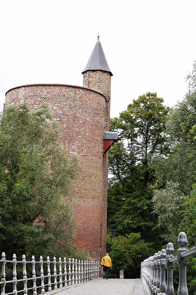 "Tower in the Minnewaterpark in Bruges (Brugge), Belgium, since the 15th century called the ""Poertoren."" This tower was once a munition depot, hence the very thick walls (more than 1 meter)."