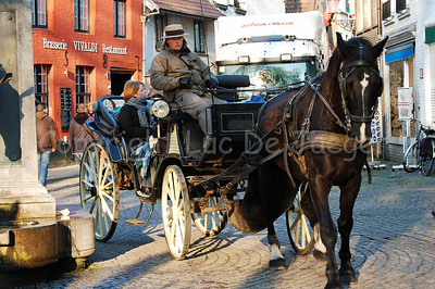 A horse and carriage that guide you through Bruges (Brugge), Belgium, at the Wijngaardplein.