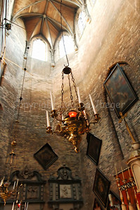 Inside the (very little) Jeruzalemkerk (Church of Jerusalem) in Bruges (Brugge), Belgium. A must-see if you visit Bruges. It's a private church, built in the 15th Century as a private Chapel and still property of the family Adornes who originally built this chapel. It is believed that the design was copied from the Church of the Holy Sepulcher in Jerusalem, which some of the members of the family had visited. Remarkable is that the church/chapel is still intact in its original form. This image is shot from the higher choir to the impressive octagonal tower.