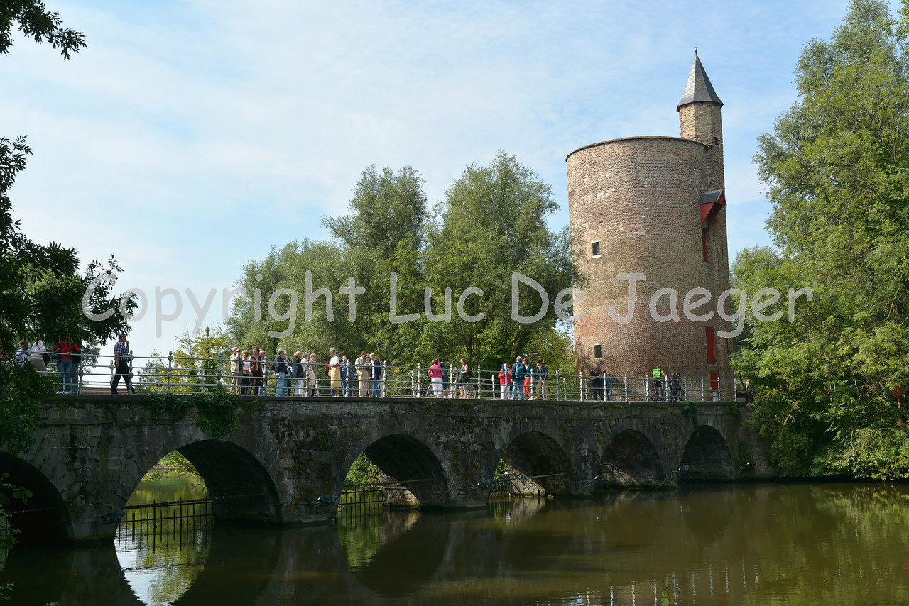 """Tower in the Minnewaterpark in Bruges (Brugge), Belgium, since the 15th century called the """"Poertoren."""" This tower was once a munition depot, hence the very thick walls (more than 1 meter)."""