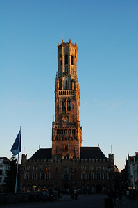 The Belfry (Belfort) and Cloth Hall (Lakenhalle) in Bruges (Brugge) at the Market Square, shot at sunset.