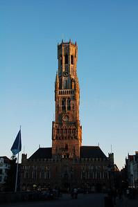 The Belfry (Belfort) and Cloth Hall (Lakenhalle) in Bruges (Brugge) at the Market Square, shot at sunset.