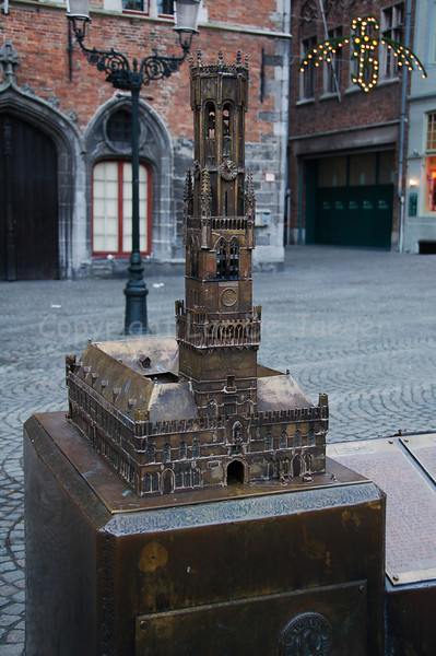 A bronze replica of the Belfry in front of the Belfry on the Burg Square in Bruges (Brugge), Belgium.