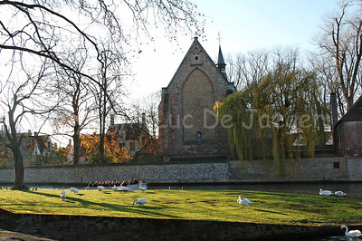 The Wijngaardplein in Bruges (Brugge), Belgium, shot late in the afternoon, before sunset. In the center, in front of you, is the church of the Beguinage.